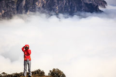 Woman photographer taking photo for beautiful landscape on Royalty Free Stock Photography