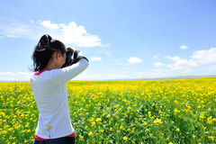 Woman photographer taking photo Stock Images