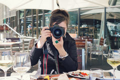Woman photographer taking a photo at lunch Stock Photo