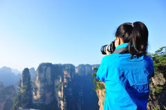 Woman photographer taking photo mountain peak Stock Photos