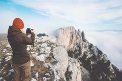 Woman photographer taking photo of mountains Royalty Free Stock Photo