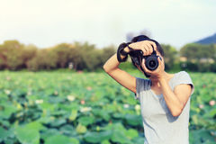 Woman photographer taking photo outdoor Stock Images