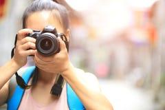 Woman photographer taking photo Stock Image