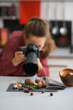 Woman photographer taking photos of autumn fruits and vegetables Stock Photo