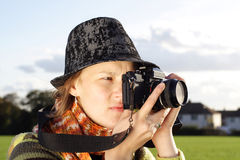 Woman Photographer taking picture. Woman photografer taking pictures on the park on a nise sunny day Stock Image