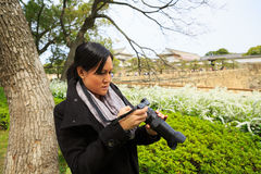 Woman photographer taking pictures in nature Royalty Free Stock Photos
