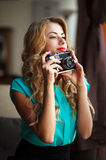 Woman photographer taking pictures with retro film camera Stock Photos