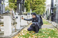 Hispanic Woman photographer taking pictures at the graveyard Royalty Free Stock Image