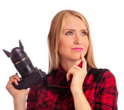 Woman photographer thinking what to shoot - isolated on white Stock Image