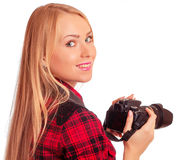 Woman photographer turn around while shooting - isolated on whit Royalty Free Stock Image