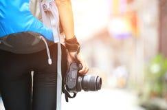 Woman photographer walking Stock Photo