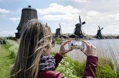 Woman Photographer Windmills At Zaanse Schans, Amsterdam, Holland Stock Photo