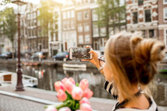 Woman photographing in Amsterdam city Royalty Free Stock Images