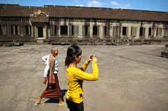 Woman photographing Angkor Wat Stock Images