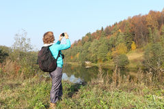 Woman. The woman with photographing an autumn landscape Stock Images