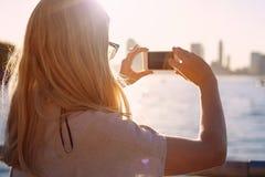 Woman photographing bay closeup Royalty Free Stock Photos