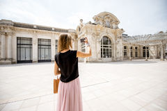 Woman near the old beautiful building in Vichy city, France Royalty Free Stock Image