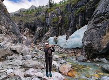Woman photographing the beauty of nature Stock Photography