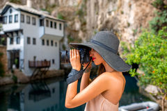 Woman photographing in Blagaj village Stock Photography