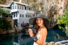 Woman photographing in Blagaj village Stock Photo