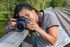Woman photographing with camera on bridge Stock Image