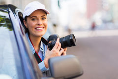 Woman photographing car Royalty Free Stock Image