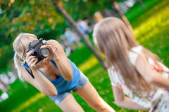 Woman photographing child Royalty Free Stock Photography