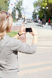 Woman photographing city's attractions Royalty Free Stock Photography