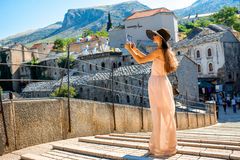 Woman photographing city view in Mostar Royalty Free Stock Photography