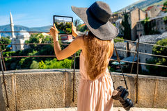 Woman photographing city view in Mostar Stock Photos