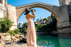 Woman photographing city view in Mostar Royalty Free Stock Photos