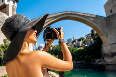 Woman photographing city view in Mostar Stock Photography