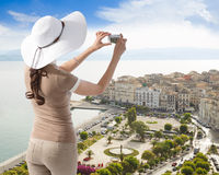 Woman photographing Corfu town Royalty Free Stock Images