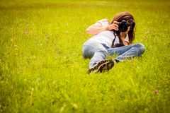 Woman photographing Stock Photography