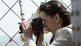 Woman photographing on Eiffel Tower stock video footage