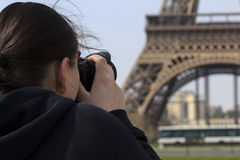 Woman photographing Eiffel Tower royalty free stock images
