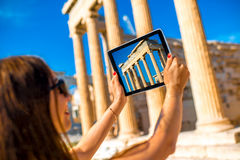 Woman photographing Erechtheum temple in Acropolis Royalty Free Stock Image