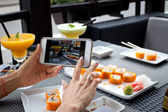 Woman photographing food Royalty Free Stock Image