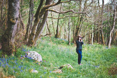 Woman photographing forest