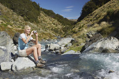 Woman Photographing Forest River Stock Photos