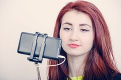 A woman photographing herself Royalty Free Stock Images