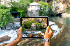 Woman photographing house on Buna spring in Blagaj Royalty Free Stock Photography