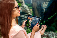 Woman photographing Meteora monastery in Greece Royalty Free Stock Images
