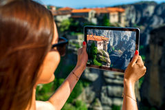 Woman photographing Meteora monastery in Greece Royalty Free Stock Photo