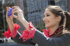 Woman photographing with mobile phone. Royalty Free Stock Photo