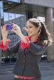 Woman photographing with mobile phone. Royalty Free Stock Images