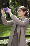 Woman photographing with mobile. Royalty Free Stock Photos