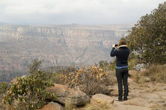 Woman photographing mountains Stock Image