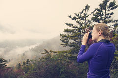 Woman photographing mountains while on a hike Royalty Free Stock Photography