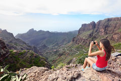 Woman Photographing Mountains on Travel Stock Photo